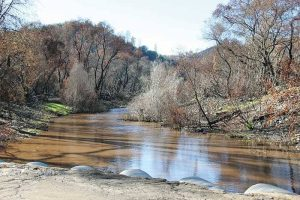 4: The unnatural color of the North Fork of the Calaveras River can be seen clearly from Hawver Road. Cuts -- photos from Joel Metzger from CCWD